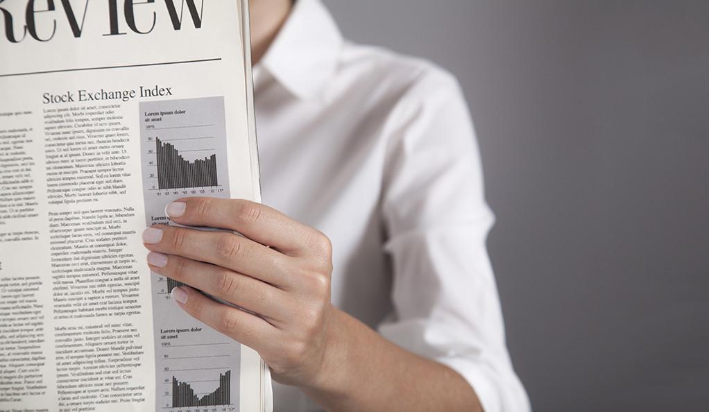 woman-reading-newspaper